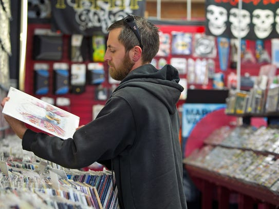 Tony Cochran, of Phoenix, looks at records at a Zia