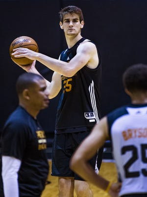Suns rookie Dragan Bender looks to pass during summer league practice at Talking Stick Resort Arena in Phoenix on July 8, 2016.