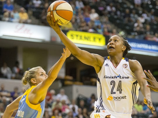 Tamika Catchings of the Fever puts in a shot as she is defended by Elena Delle Donne of the Chicago Sky at Bankers Life Fieldhouse, Indianapolis, Friday, June 26, 2015.