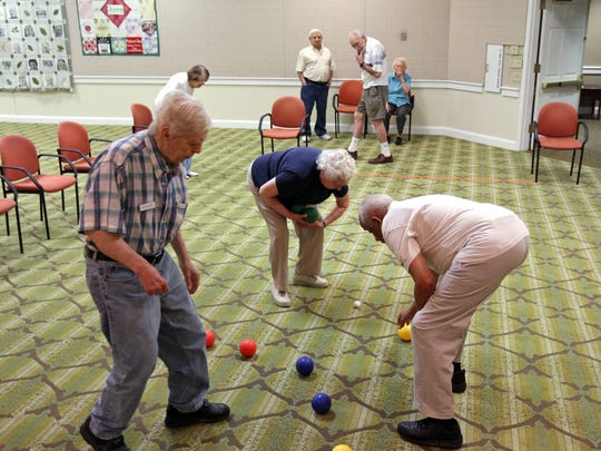 Residents of Arbor Glen in Bridgewater play bocce three