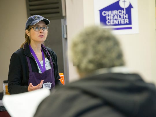 Carolyn Nichols, nutrition education coordinator for Church Health, explains the nutrition behind the dish they are making.