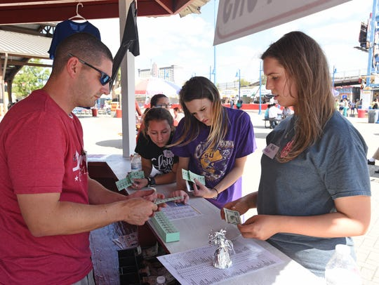People purchase food tickets at the 2017 Red River