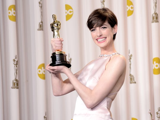 "Anne Hathaway, winner of the Best Supporting Actress award for ""Les Miserables"""