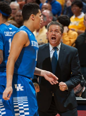 Kentucky coach John Calipari, right, discusses the play of Devin Booker, left, as Booker is taken out of the game during the first half of an NCAA college basketball matchup against Missouri on Thursday, Jan. 29, 2015, in Columbia, Mo. (AP Photo/L.G. Patterson)