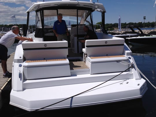The new 390 Express Coupe, built by Cruisers Yachts, Oconto, is one of several new boats unveiled to the public for the first time this weekend at Stone Harbor in Sturgeon Bay. This one sells for $540,000.