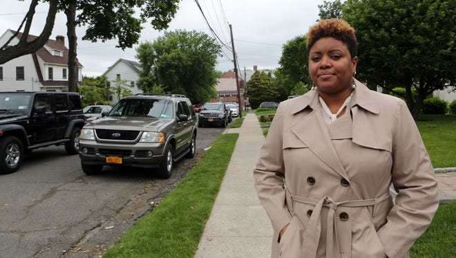 Lori Hall Armstrong, who feels unsafe on her block due to speeding cars, outside her home in New Rochelle.