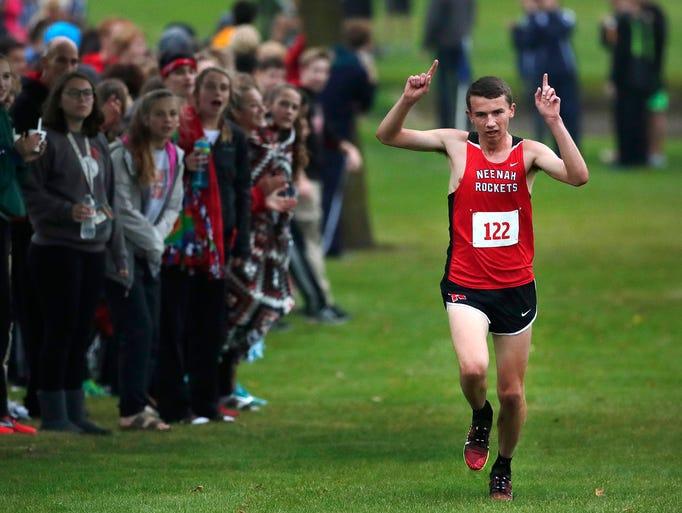 Neenah High School's Matt Meinke raises his arms in