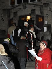 """Belinda Paisley, of Granville, sings """"Here We Come A-wassailing""""  during the 2014 Sights and Sounds of Christmas walk. on Thursday, Dec. 4, 2014."""