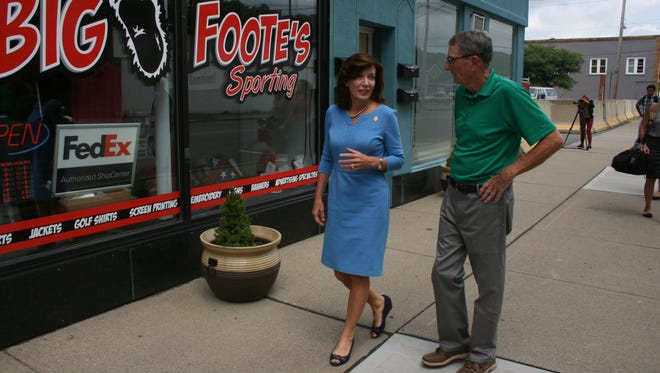 New York Lt. Gov. Kathy Hochul speaks to Waverly Mayor Dan Leary while touring the village's downtown Wednesday.