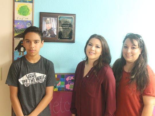 Left to Right: Chris Mirabal's son Nathan Mirabal, daughter  Kennedy Mirabal and his wife Nicole Mirabal standing in the new Chris Mirabal Children's Room at Kid's Inc.