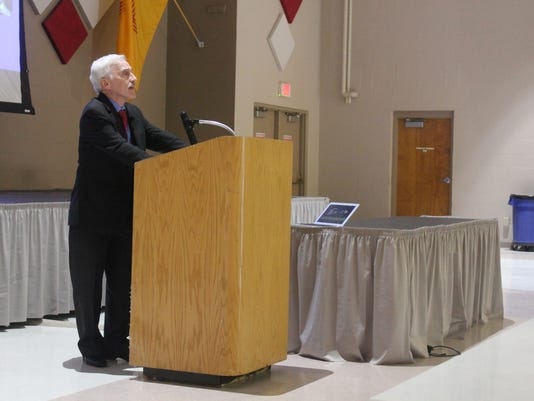 Dr. Jeffrey Simon at the podium in Alamogordo
