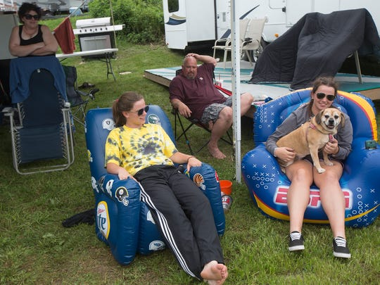 Hannah Hawkins, 17, of Runnells, relaxes with her sister Sarah, 19, and their dog Betsy Ross while camping with their parents at the Iowa State Fair campgrounds in Des Moines, Sunday, Aug. 7, 2016.