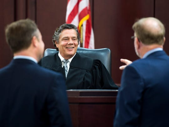 Judge Gale Robinson, center, chats before hearing a