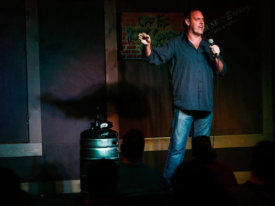 Comedian David Nickerson performs at Off The Hook Comedy Club's new location in Bonita Springs on Thursday, July 17, 2014. Scott McIntyre/Staff