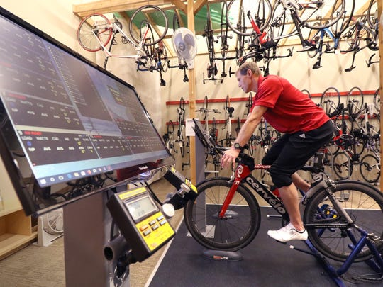 Dwight Sandvold of Fitness and Sports Training in the cycle studio at the Hartland Movement Center at 592 W North Shore Drive in Hartland that is home to six different fitness businesses.