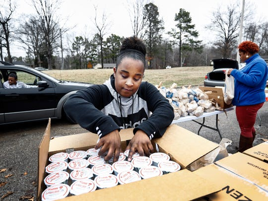 Mid-South Food Bank volunteer Morgan Darden counts