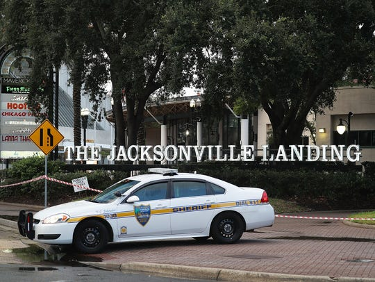 A Jacksonville Sheriff officer helps keep the perimeter