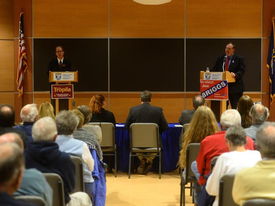 The Cascade County commissioner debate between Mitch Tropila, left, and the incumbent Joe Briggs gets underway in Heritage Hall at Great Falls College MSU on Friday evening.