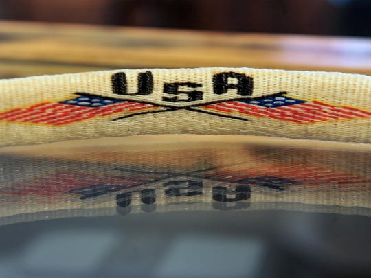Robert Kazmierczak, a Montana State Prison inmate, learned to hitch horse hair while serving his sentence and now sells his work, like this patriotic belt, in the Montana State Prison Hobby Store in Deer Lodge.