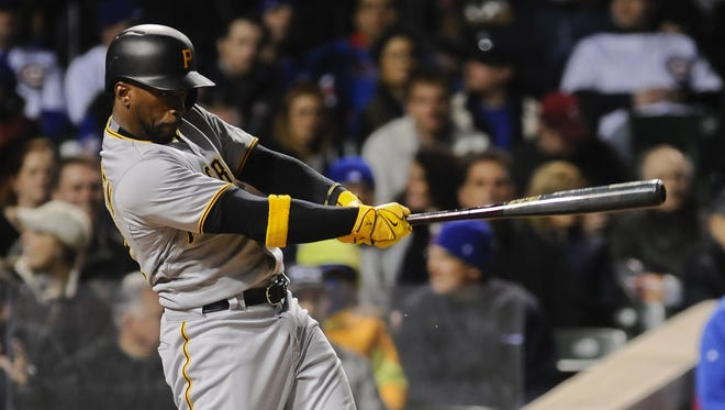 Pirates center fielder Andrew McCutchen hits a  triple against the Cubs in the sixth inning at Wrigley Field.