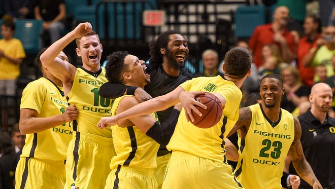 March 12, 2016: Oregon Ducks players celebrate after the championship game of the Pac-12 Conference tournament against the Utah Utes at MGM Grand Garden Arena. The Ducks defeated the Utes 88-57.