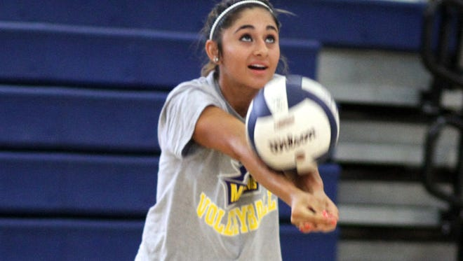 """Junior Lady Cat Libero Julyssa """"Boo"""" Ortiz will be counted on to provide leadership from the back court."""