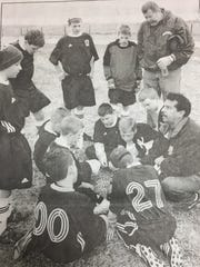 Union County YMCA soccer coach Jose Perez, right, talked