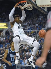 Nevada's Jordan Caroline dunks in a win over Rhode