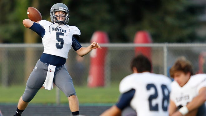 Xavier quarterback Zach Simons warms up prior to an Eastern Valley Conference football game against Little Chute on Sept. 5.