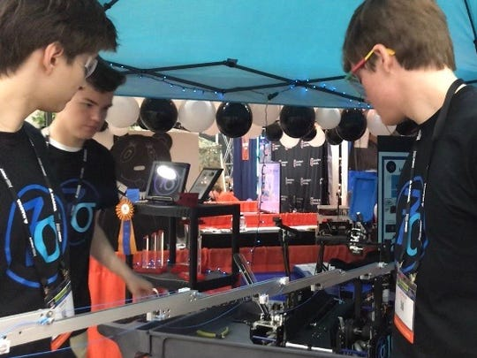 The 7 Sigma Robotics Team from Cincinnati, Ohio extending