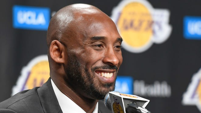 Former Lakers player Kobe Bryant speaks to the media prior to the Lakers' game against the Golden State Warriors at Staples Center.