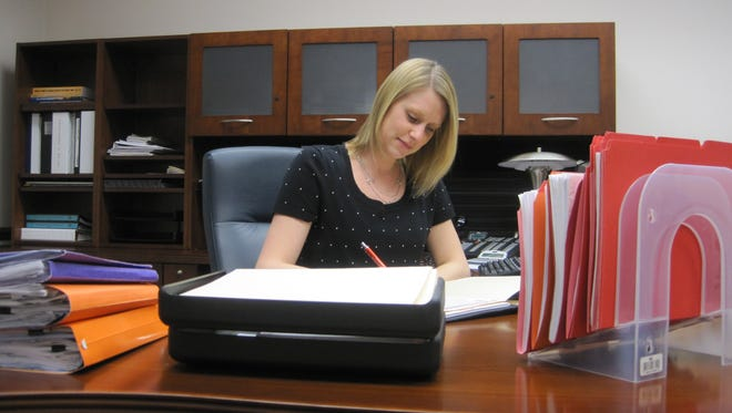Valerie Shaffer works  at her desk at the office of the Economic Development Corporation of Wayne County.