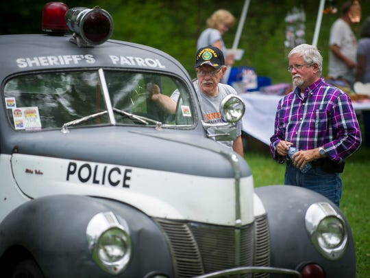 Local residents check out old law enforcement vehicles during Honor Fountain City Day on Monday, May 29, 2017.