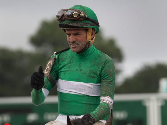 Kent Desormeaux celebrates after winning the 2016 Haskell Invitational at Monmouth Park  aboard Exaggerator.