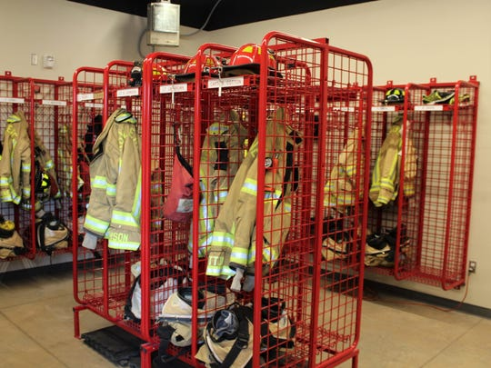 Fire gear hangs near the Station No. 3 engine, ready