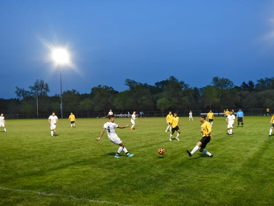 Players face off under the lights during a St. Cloud Dynamo FC game against Waconia Thursday, May 17, at Whitney Park in St. Cloud.