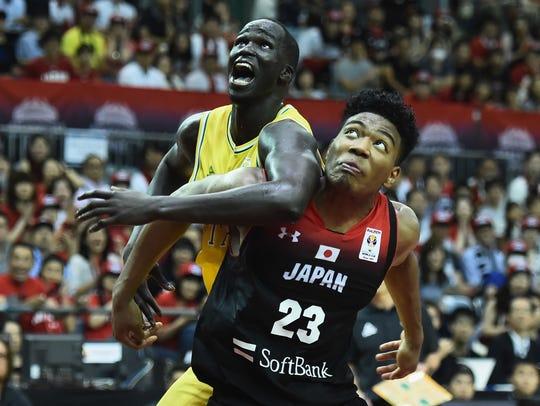 Rui Hachimura of Japan struggles against Thon Marial