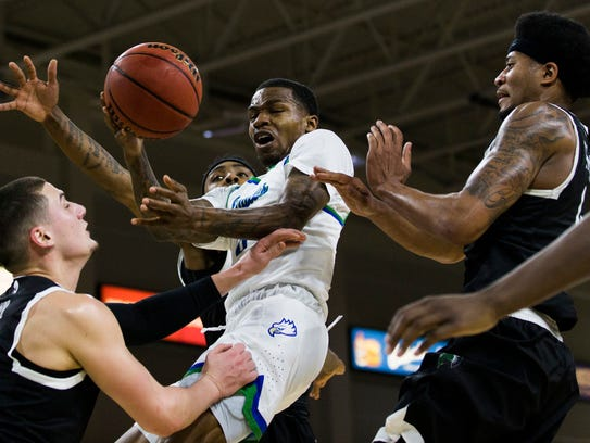 Florida Gulf Coast University guard Brandon Goodwin goes in for a layup during the Atlantic Sun men's basketball tournament quarterfinal against USC Upstate at Alico Arena on Monday.