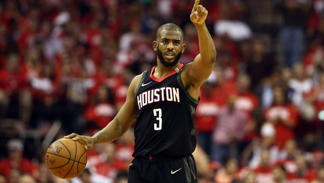 Houston Rockets guard Chris Paul (3) brings the ball up the court during the second quarter in game five of the Western conference finals of the 2018 NBA Playoffs against the Golden State Warriors at Toyota Center.