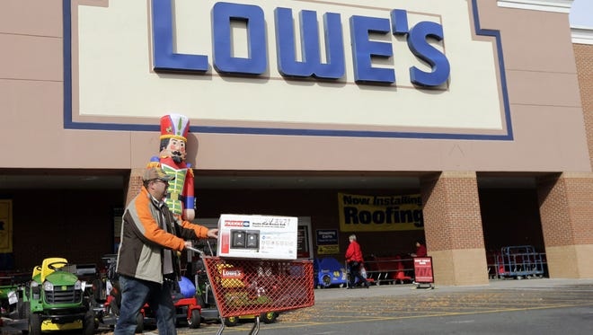 A customer leaves a Lowe's home improvement store in Matthews, N.C.,