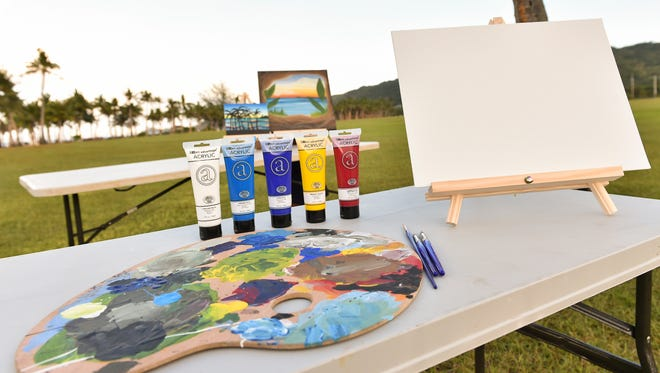 """Painting supplies are displayed at the War in the Pacific National Historical Park in Asan on Jan. 8, 2017 as a preview for the park's upcoming third annual """"Art in the Park"""" guided painting sessions."""