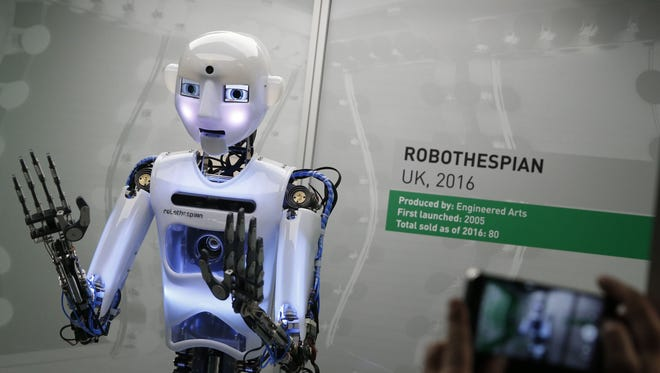 The RpboThespian is a British-built, life-size robot, shown during a press preview for the Robots exhibition held at the Science Museum in London.
