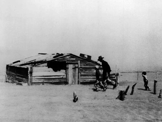 An Oklahoma farmer and his two sons battle the wind in this 1936 photo of the Dust Bowl taken by Arthur Rothstein. As much of the nation is parched by drought, much of the Dust Bowl - the 97 million-acre confluence of New Mexico, Texas, Oklahoma, Colorado and Kansas that turned to desert a half-century ago - has been spared.