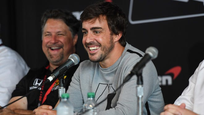 Fernando Alonso laughs alongside Andretti Autosport owner Michael Andretti (left) speaks at a press conference prior to the Honda Indy Grand Prix of Alabama at Barber Motorsports Park. Mandatory Credit: Shanna Lockwood-USA TODAY Sports