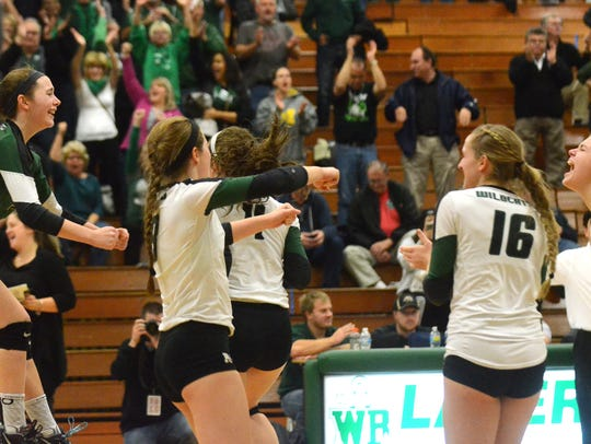 Novi's Claire Pinkerton (far left, green jersey) jumps