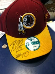 Redskins' quarterback Robert Griffin III signed the hat of a Redskins fan when he visited the Centre at Salisbury on Thursday afternoon.