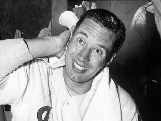 Bob Feller, of Van Meter, wipes off in the dressing room in May 1955, after throwing a one-hit win against the Boston Red Sox.