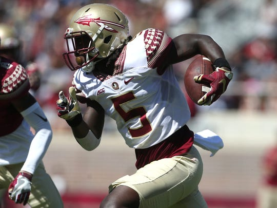 FSU's Da'Vante Phillips tries to get past Stanford Samuels III during their Garnet and Gold spring game at Doak Campbell Stadium on Saturday, April 8, 2017.