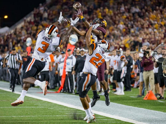 Sep 1, 2016; Minneapolis, MN, USA; Minnesota wide receiver Rashad Still (88) attempts to catch a pass as Oregon State safety Brandon Arnold (3) and cornerback Xavier Crawford (22) play defense in the second half at TCF Bank Stadium.