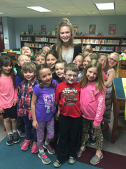 Howell senior Shelby Douglas surrounds herself with her first grade students she aids as part of the Howell High School early childhood education program.